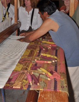 Rug weaving with natural dyes.
