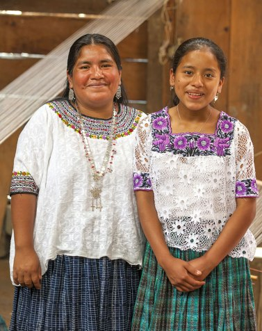 Weaver Amalia Gue (L) and her daughter Martita from Samac, Guatemala. Amalia wears her handwoven brocade gauze blouse.