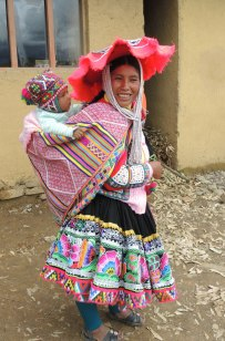 Peruvian Huacatinco woman and her baby traditionally dressed.