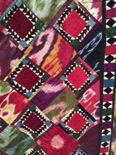 Detail of patchwork and embroidered hanging (quroq ruja); Uzbekistan; c,1870-1800. Collection of International Quilt Study Center and Museum.