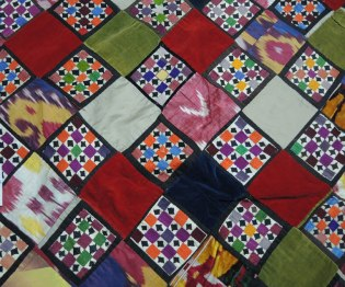 Section of quilt with ikat, embroidered and velvet patches, possibly Uzbekistan from my collection.