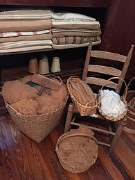 Brown and white cotton fiber and woven blankets.