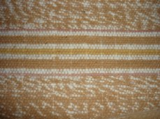 Handwoven striped brown cotton blanket.