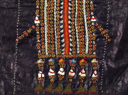 Detail of indigo-dyed dress (zanna or zinna) Jabal Haraz, Yeman, 197-1980s Cotton, silk, mother-of-pearly, brass sequins and chains Dress: length 120 cm/ width 144 cm As2002,06.11 Dress: Gift of Carl Phillips © 2017 The Trustees of the British Museum/ Thames & Hudson, London; From the collection of the British Museum