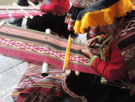 Sallac weavers work on traditional ikat