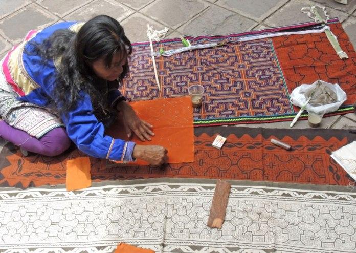 Shipibo artisan from the Peruvian Amazon demonstrates mud painting