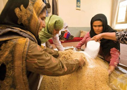 The women of Kandahar Treasure work together to prepare a special dish for the annual charity on Prophet Muhammad's birth. Photo credit ©Paula Lerner/Aurora Photos.