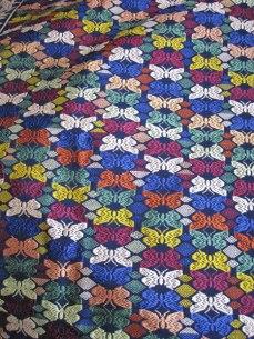 Butterfly motifs in silk using supplementary weave.