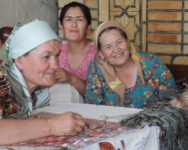 Embroidering the traditional suzani cloth.