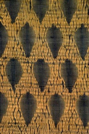 "Detail pattern of a stitched shibori ""mokume"" or wood-grain design."