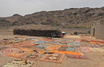 Rugs outside the walled compound.