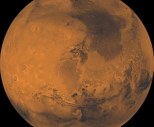 Mars disappears behind the moon tomorrow, and the two are joined at night in the sky of Saudi Arabia