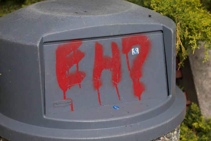 Graffiti on a trash can in British Columbia.
