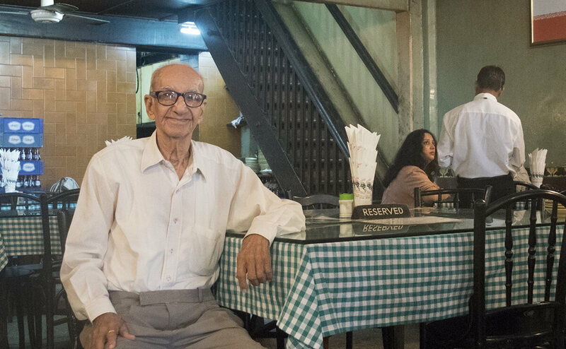 94-year-old Boman Kohinoor sits in his family's famous Britannia restaurant in the Fort neighborhood of South Mumbai.