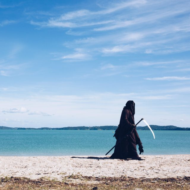 The Swim Reaper, out doing his own special kind of beachcombing.