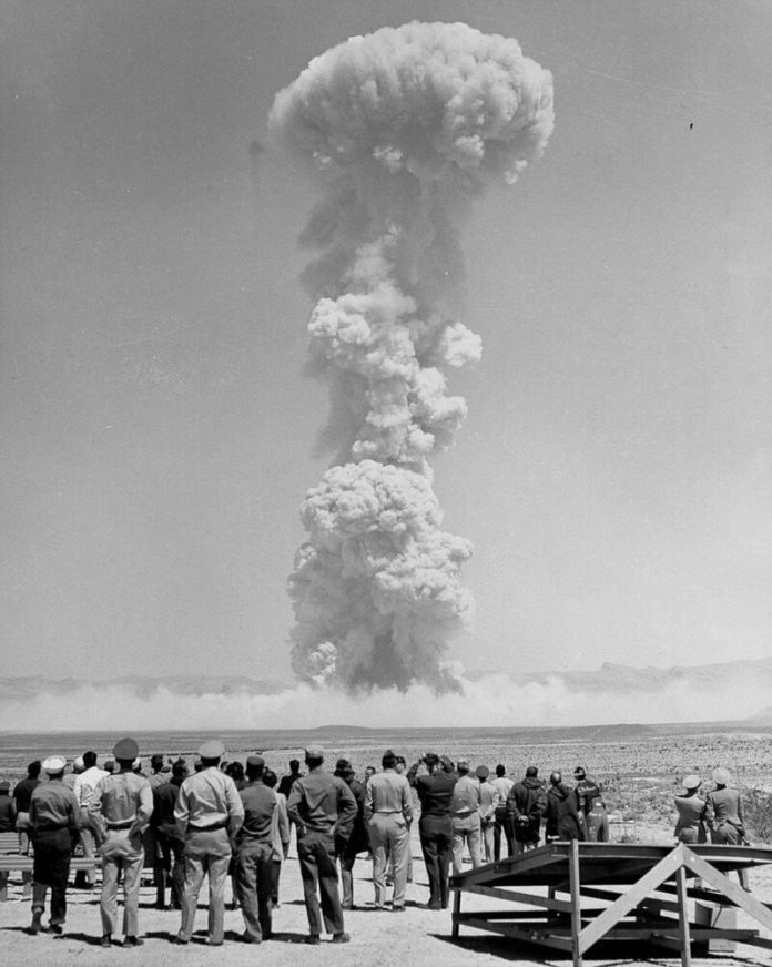 Onlookers watch a test called MET during Operation Teapot.