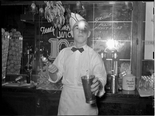 The soda jerk might be expected to flip ice-cream scoops for his customers' enjoyment.