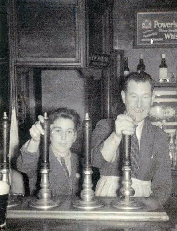 Eugene, aged 8, pulling a pint with his uncle Fintan at the pub.