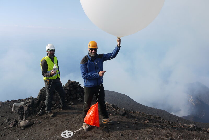 Researchers get ready to launch a balloon sensor over Stromboli.
