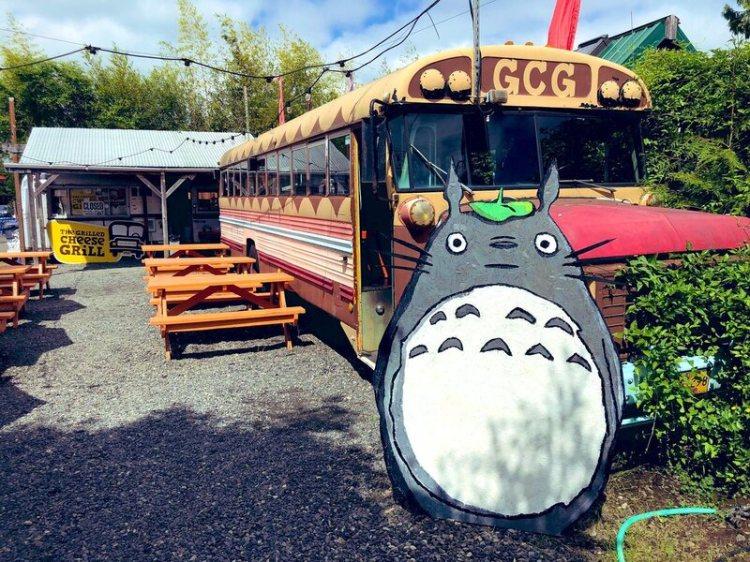 Bennett parked a cutout Totoro near a bus.