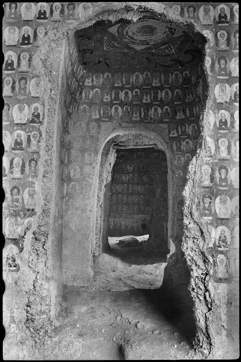 Mogao Cave 267. Northern Liang (420–439). North wall and ceiling, seen from Cave 266. Visible in the distance, north wall of Cave 272. Lo Archive photograph, 1943–44. Princeton University (Lo 267-1).