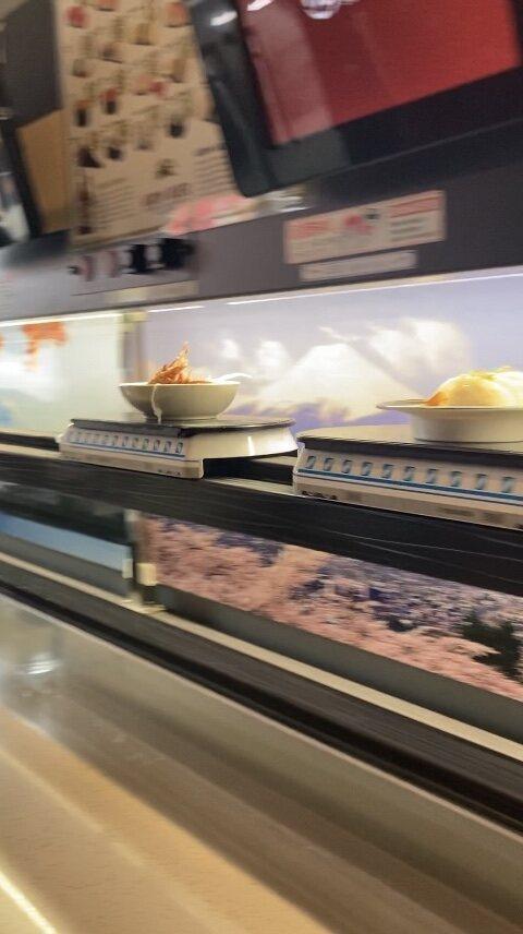 Sushi and salads zooming by at Hikari Bullet Train Sushi in San Francisco.
