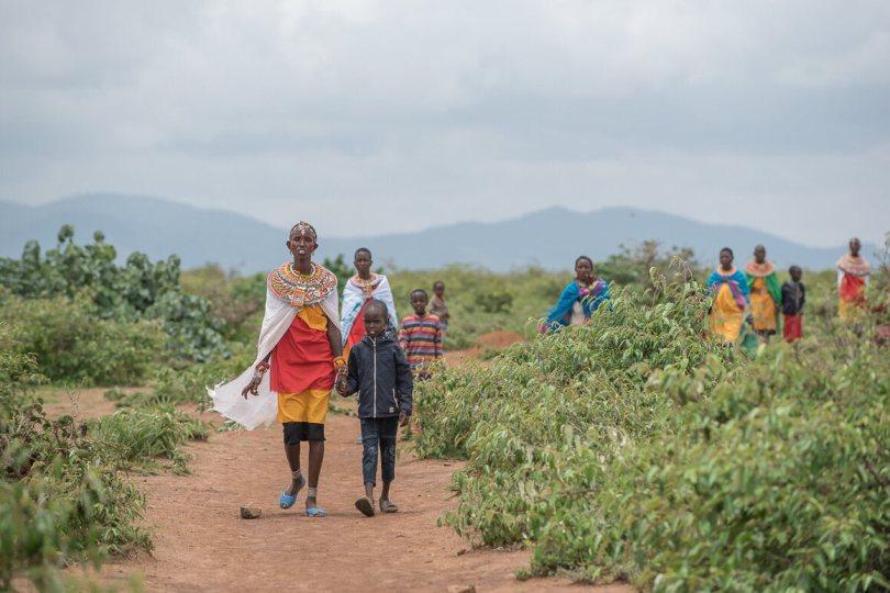 Samburu women and their children walking near Kirisia forest.