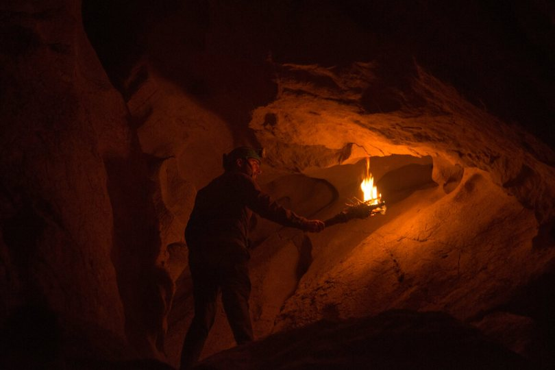The experience of moving through a cave by torchlight is far different than with modern light sources.