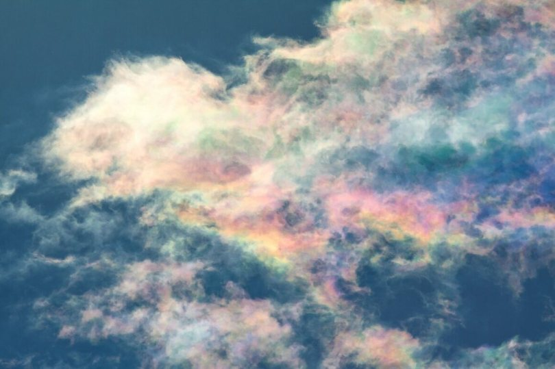 Iridescent clouds look like melted sherbet.