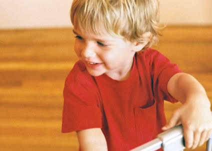 photo of smiling blonde toddler boy in red shirt