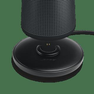 SoundLink Revolve speaker being placed on the optional charging cradle