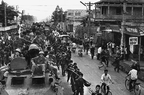 Jubilant communist troops sit on top of trucks and armored personnel carriers in Saigon at war's end April, 1975.