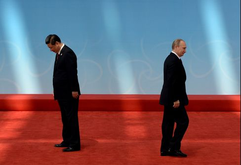 Russian President Vladimir Putin after being greeted by Chinese President Xi Jinping before the opening ceremony of the CICA summit in Shanghai on May 21, 2014.