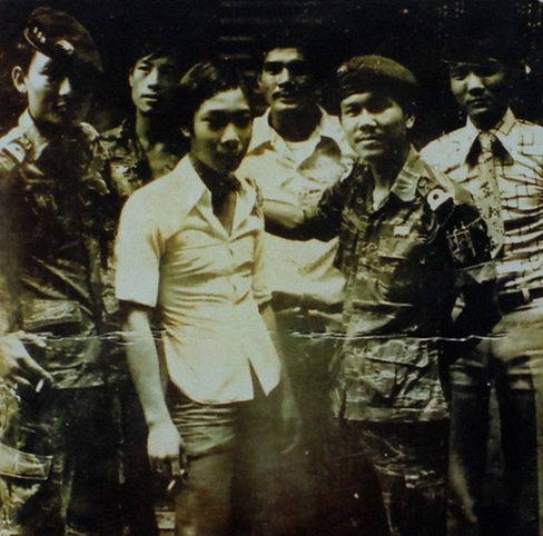 Vu Tien's father, far right, stands with comrades of the former Republic of Vietnam military.