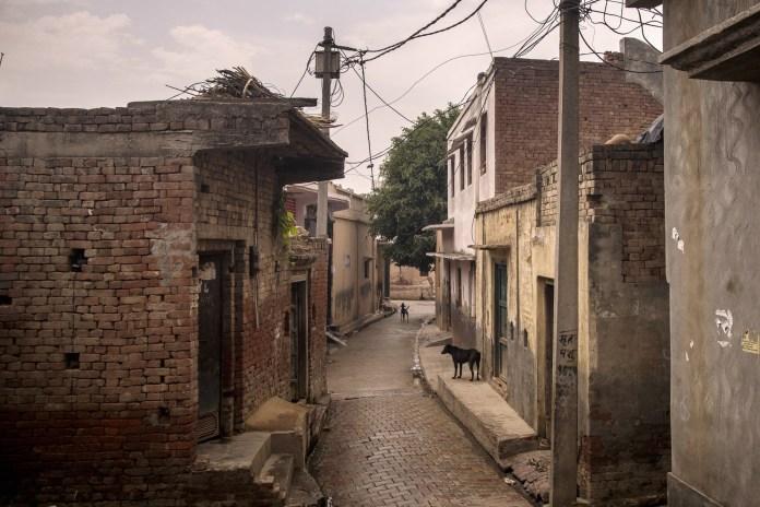 General view of deserted road in Bassi village in Baghpath, Uttar Pradesh, India
