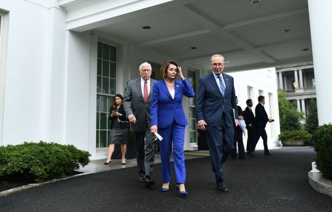 Steny Hoyer, Nancy Pelosi and Chuck Schumer walk out of the White House after a meeting in Washington on Oct. 16.