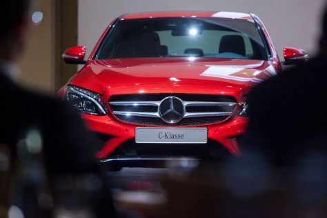 A Mercedes C-Class automobile stands on display during a Daimler AG news conference in Stuttgart, Germany, on Thursday, Feb. 6, 2014. Photographer: Krisztian Bocsi