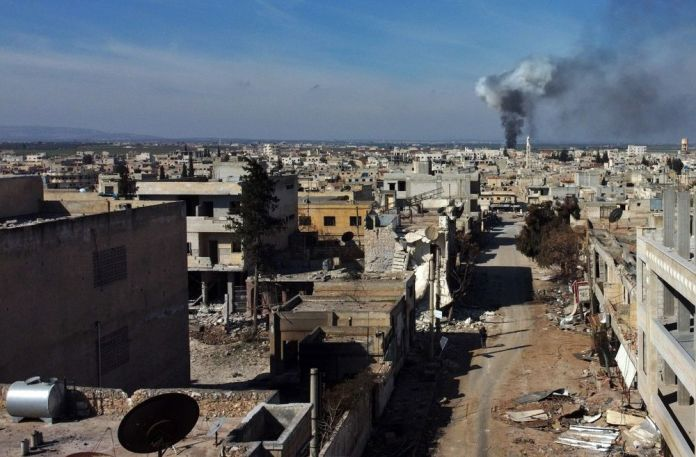 Smoke billows over the town of Saraqib in the eastern part of the Idlib province in Syria on Feb. 27.