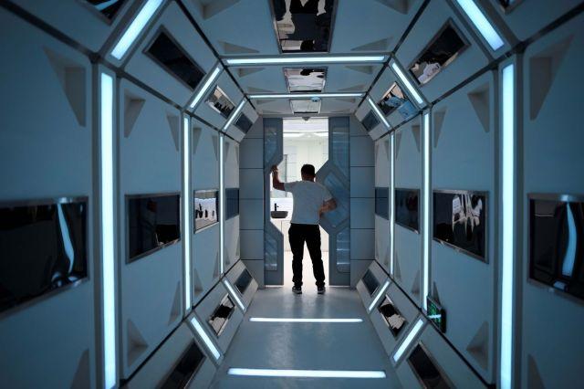 A man walks down a corridor inside Mars Base 1.