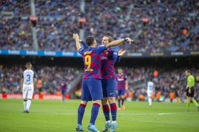 Antoine Griezmann withLuis Suarez of Barcelona.
