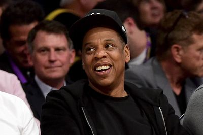 LOS ANGELES, CA - APRIL 13: Jay-Z smiles as he sits courtside as the Los Angeles Lakers take on the Utah Jazz at Staples Center on April 13, 2016 in Los Angeles, California. NOTE TO USER: User expressly acknowledges and agrees that, by downloading and or using this photograph, User is consenting to the terms and conditions of the Getty Images License Agreement. (Photo by Harry How/Getty Images)