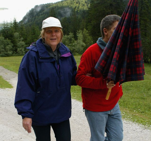 German Chancellor Angela Merkel and her husband Joachim Sauer go for a walk on August 3, 2006 in Sexten, Italy. Merkel and Sauer are currently spending their holiday at the Alte Post hotel in the small town of Sexten in the Dolomite Alps, South Tyrol.