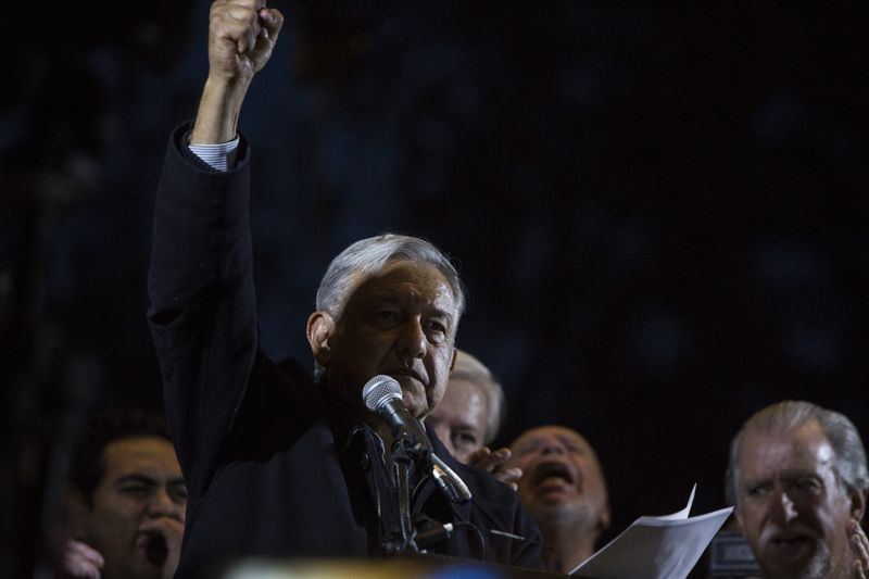 "Andres Manuel Lopez Obrador, president of the left-wing political party National Regeneration Movement (MORENA), appears on stage during an event in Los Angeles, California, U.S., on Sunday, Feb. 12, 2017. The politician known locally as Amlo is the early frontrunner in Mexico's 2018 presidential race. Amid a spasm of national rage, voters are increasingly sympathetic to the cries of a radical outsider who promises to end a relationship of ""subordination"" to the U.S. and rebuild the domestic economy. Photographer: Dania Maxwell/Bloomberg"