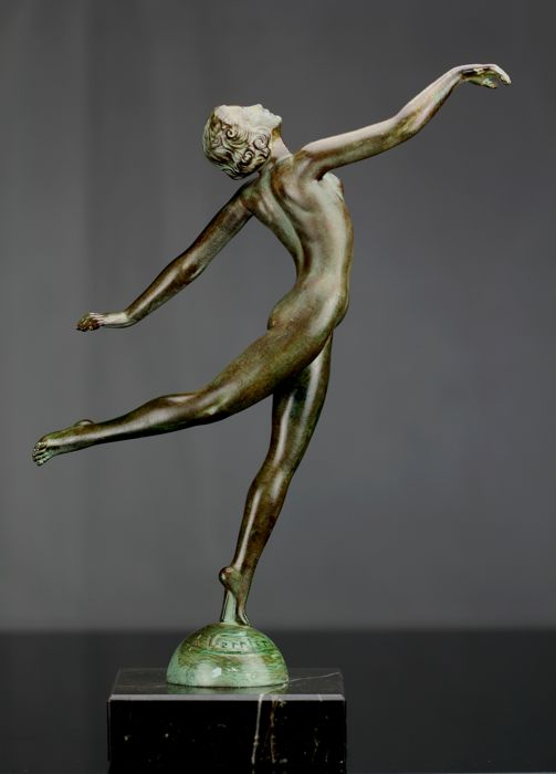 art deco statue naked young woman