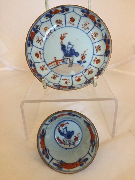 Tea bowl and saucer (2) - Chinese imari - Porcelain - Jumping boys - China - Kangxi (1662-1722) - Catawiki