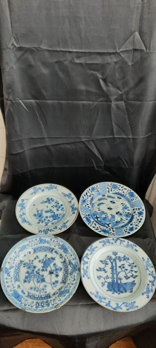 Plates (4) - Blue and white - Porcelain - butterflies, trees, birds, flowers, lotuses - China - Kangxi (1662-1722)