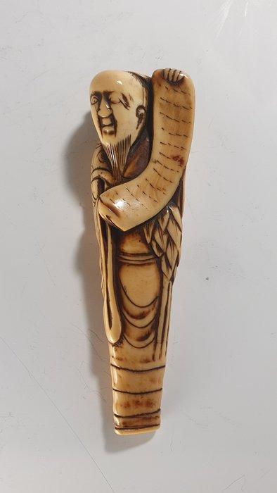 Netsuke - Ivory - Sennin with scroll - Japan - Edo Period (1600-1868)