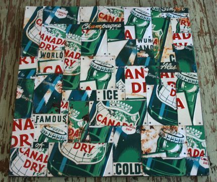I found 12 old tin signs that used to hang in grocery and liquor stores to create this patchwork of wall art. Many of them were in sad shape with rust setting in so it didnt feel so bad cutting them up. I just love the graphics and the colors!