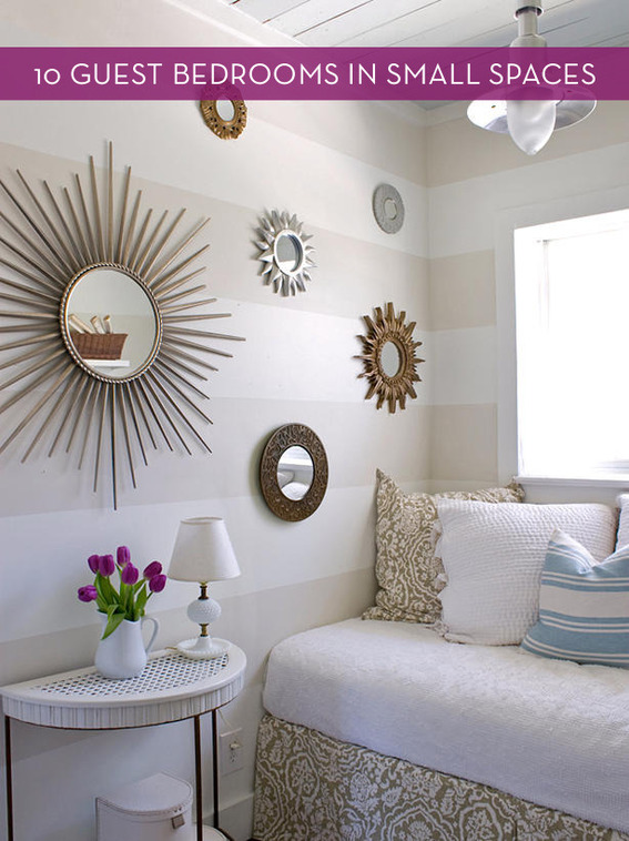 A small guest bedroom nook with striped walls and gold accents.