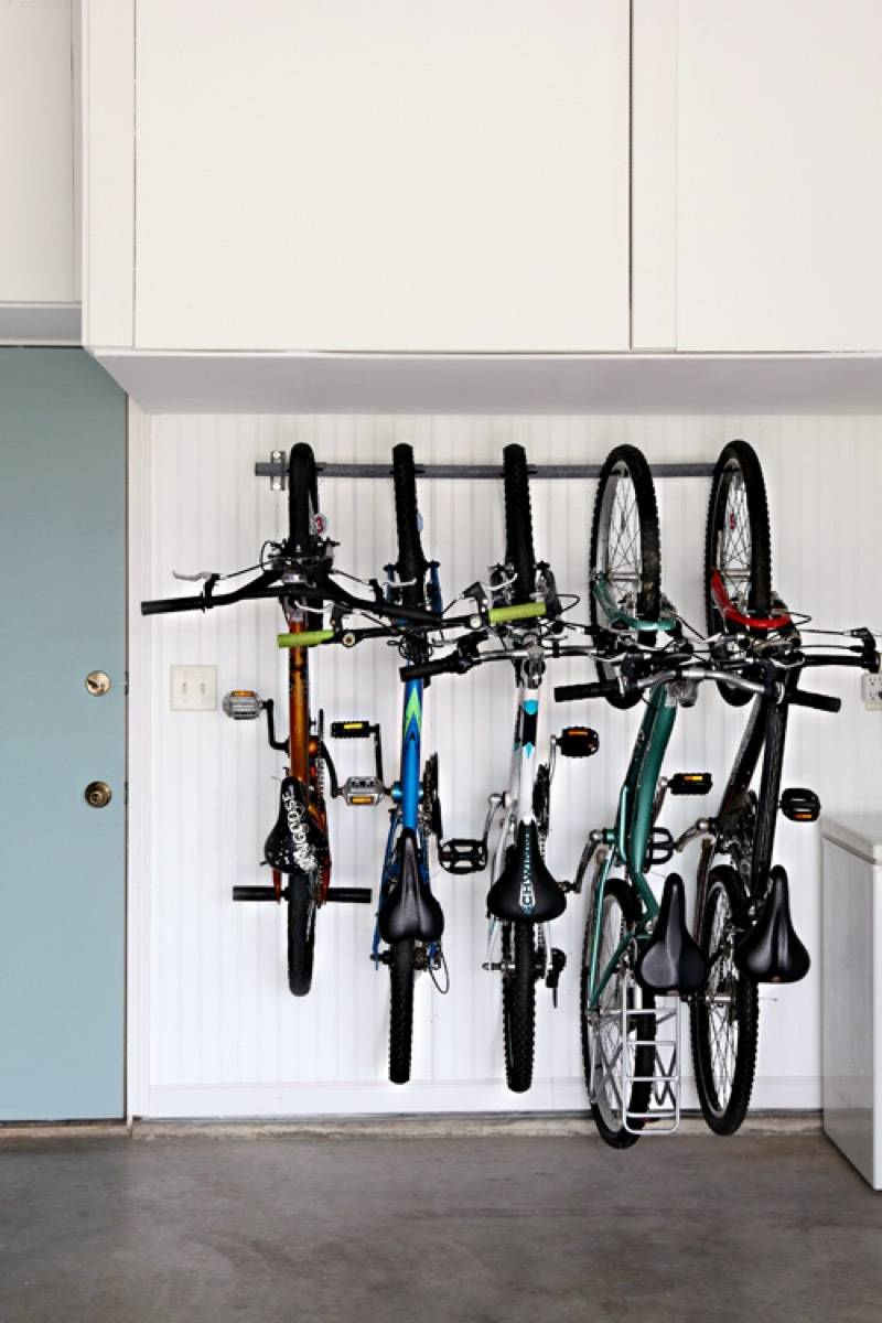 Bikes stored vertically take up way less room | 72 Organization Tips and Projects for Every Space in Your Home